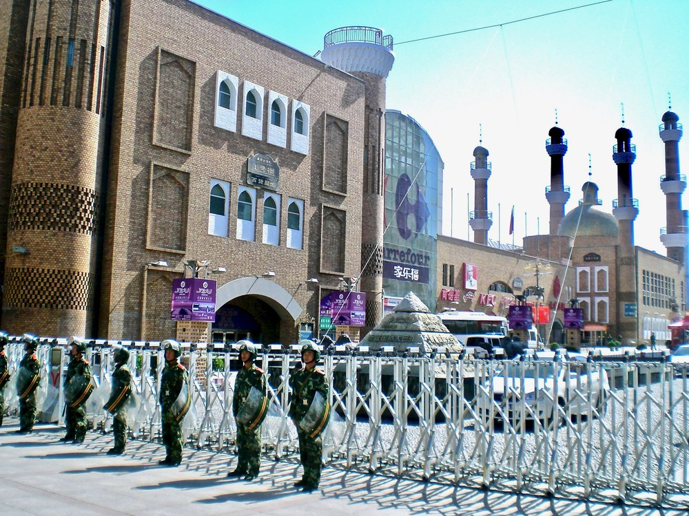Soldiers guarding the road to a mosque in Urumqi, Xinjiang, China. (C) Remko Tanis