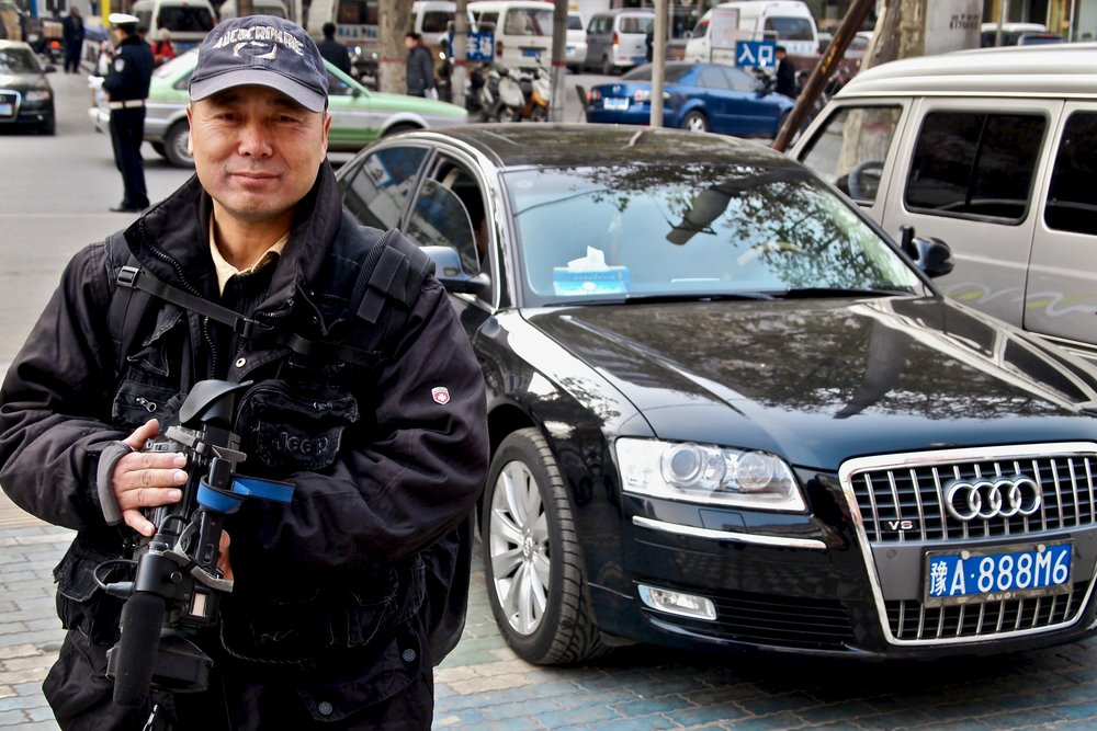Lu Jianfu at work with his camera, filming government cars in Zhengzhou, China. (C) Remko Tanis