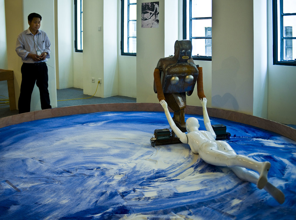 A robot build by farmer-inventor Wu Yulu, imitating French artist Yves Klein at work.