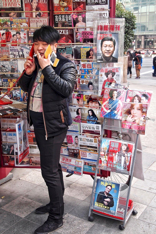 A smoker near Shanghai Railway Station. Photo: (C) Remko Tanis