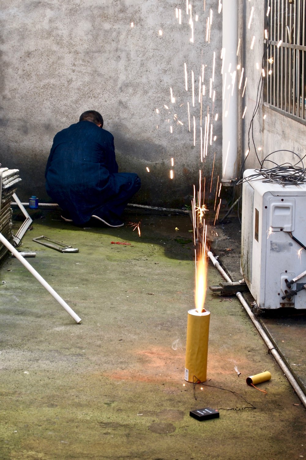 An employee testing fireworks at Dream Fireworks factory in Liuyang, China. Photo: (C) Remko Tanis