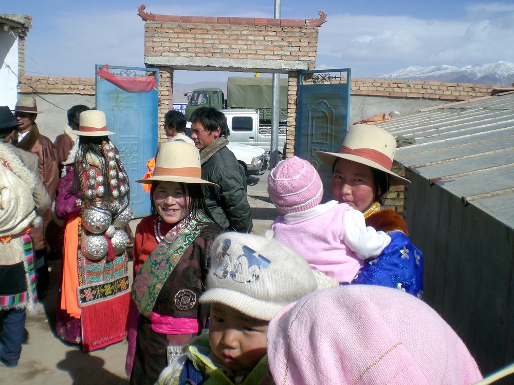 A Tibetan family at a wedding in Rigmon, Qinghai province, China. Photo: (C) Remko Tanis