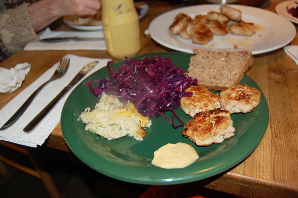 Danish dinner: frikadeller (meatballs), kartofler (potatoes), red cabbage, and rugbrød (rye bread)