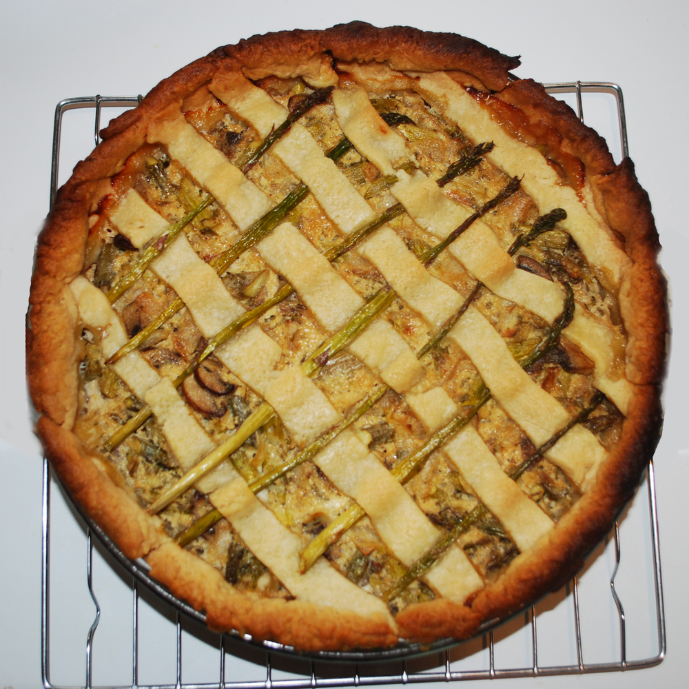 Teresa's spring vegetable pie with creme fresh and woven asparagus top.