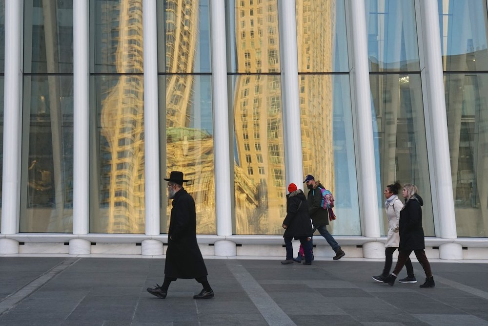 Passersby Reflected in the Oculus, NYC.
