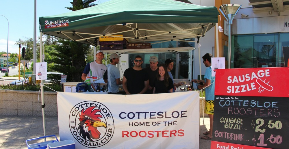 Pictured: Roosters members and volunteers at the Club's fundraising sausage sizzle.