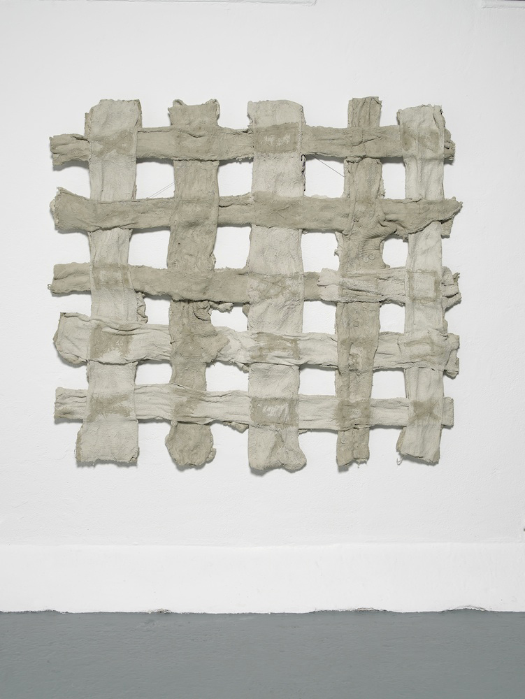 Extent  2011  Cloth, mortar, thread  140 x 127 x 10 cm / 55.1 x 50 x 3.9 in