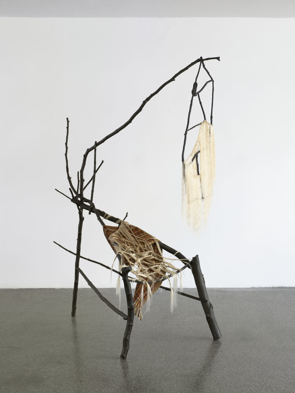 Auntie Yaa Yaa  2010  branches, paint, screws, human hair, scarf, hair, hair ties, wire, needles  231 x 107 x 160 cm / 90.0 x 42 x 62.9 in
