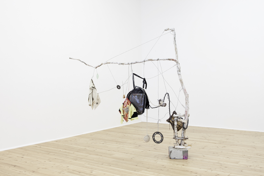 SOULUTION  2010  Wood, concrete, fabric, yarn, metal, chains, picture frame, bag, paint, soap, ceramics, polystyrene, dried orange  223 x 222 x 64 cm / 87.7 x 87.4 x 25 in