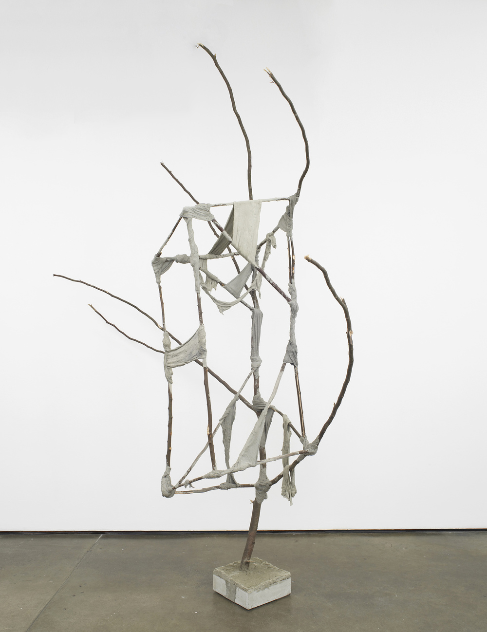 Jungle Camp (Spax Galore) 2012 Concrete, metal, screws, plaster bandages, branches 266 x 250 x 71 cm / 104.7 x 98.4 x 28 in