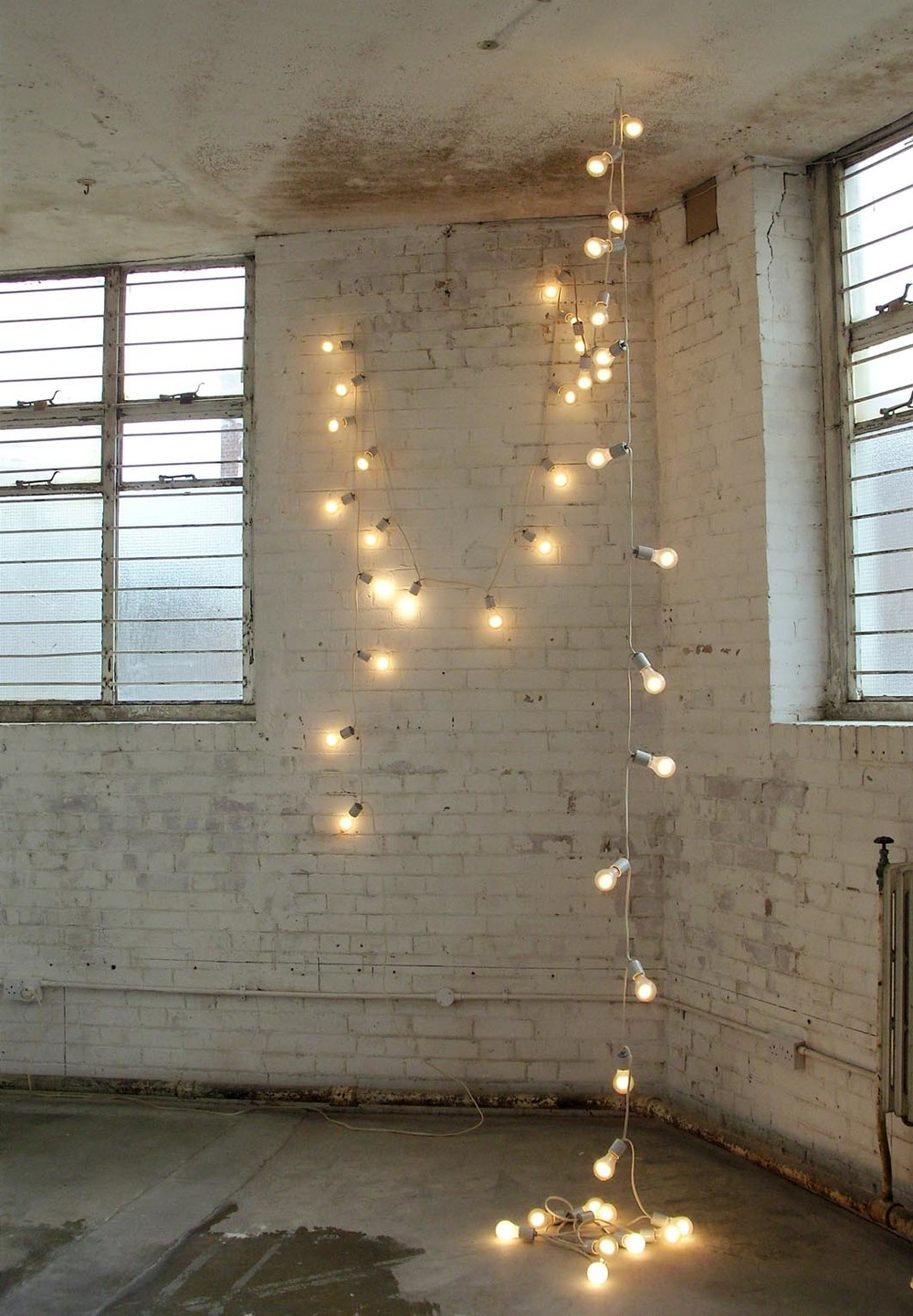 "Felix Gonzalez-Torres   ""Untitled"" (America) #2   1992   42 Light Bulbs, Extension Cords, Porcelain Light Sockets:   Installation Variable"