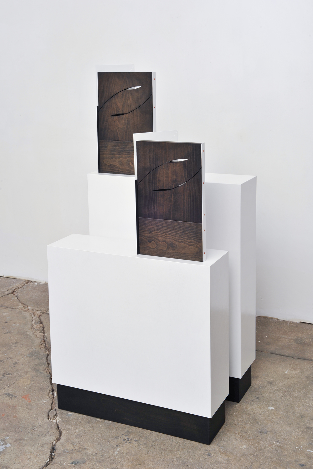 Wedges 2014 Euro-beech hardwood, steel, copper rivets, enamel, wax 2 parts, each: 48.5 x 40.6 x 11.4 cm / 19.1 x 16 x 4.5 in Plinths: 81.2 x 60.9 x 17.7 cm / 32 x 24 x 7 in and 60.9 x 60.9 x 17.7 cm / 24 x 24 x 7 in