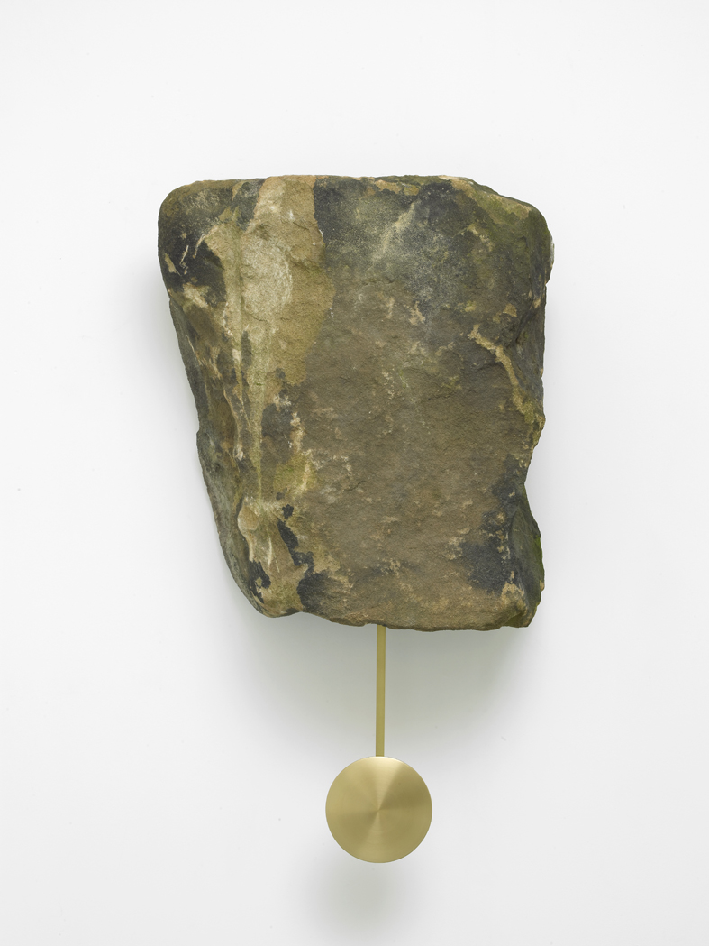 Klaus Weber Clock Rock 2015 Yorkstone rock, brass pendulum, clock movement 57 x 52 x 27 cm / 22.4 x 20.5 x 10.6 in (stone) 88.5 x 52 x 27cm / 33.7 x 20.5 x 10.6 in (with pendulum)