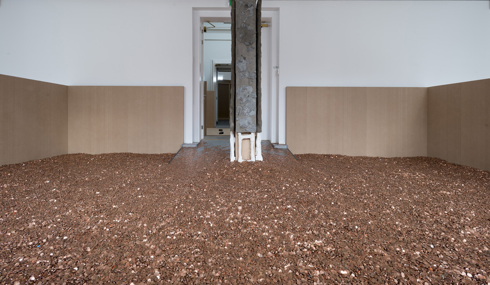 now (Working Title), United Kingdom poverty line of Sixteen thousand seven hundred pounds sterling translated at an exchange rate of 1.27 on Christmas day 2014 into two million one hundred and twenty thousand nine hundred euro cents 2015 Concrete, coins 4 sculptures, each: 240 x 45 x 6 cm / 94.4 x 17.7 x 2.3 in