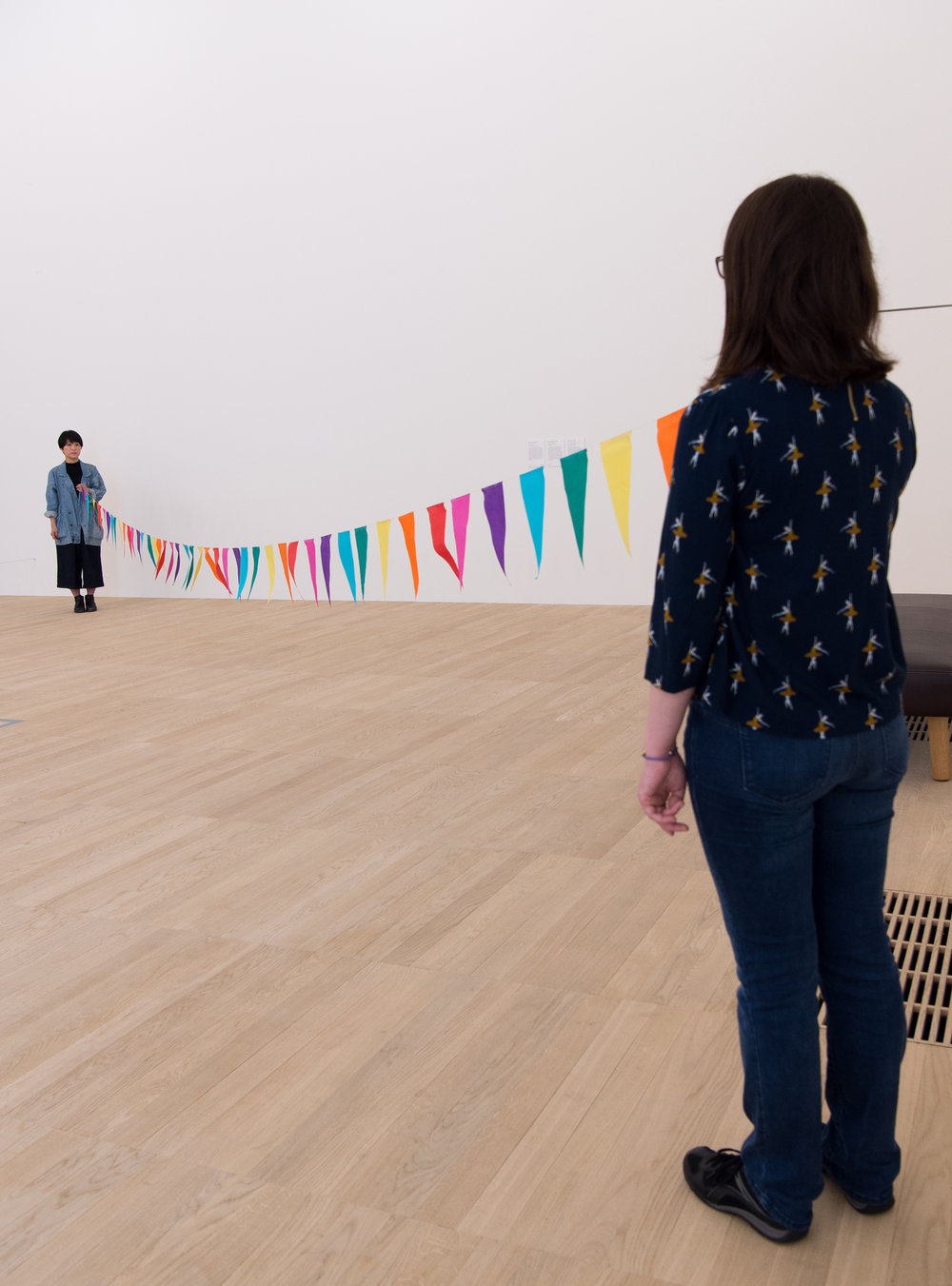 Strangers  2008-2011  Paper bunting and performers  Dimensions variable  Switch House, Tate Modern, London, UK  2016
