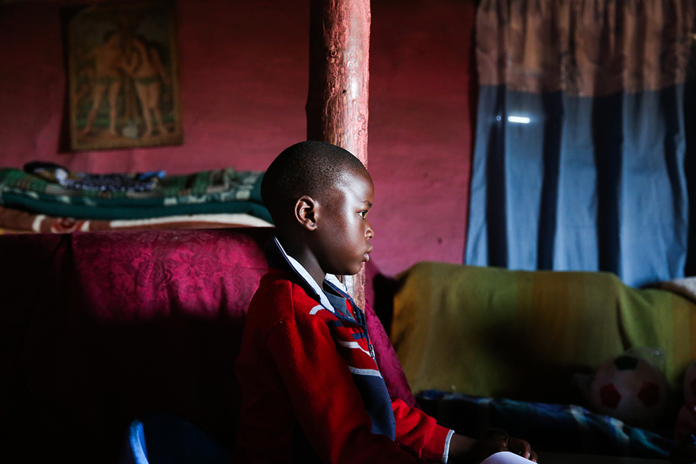 young boy in rural home in the Free State