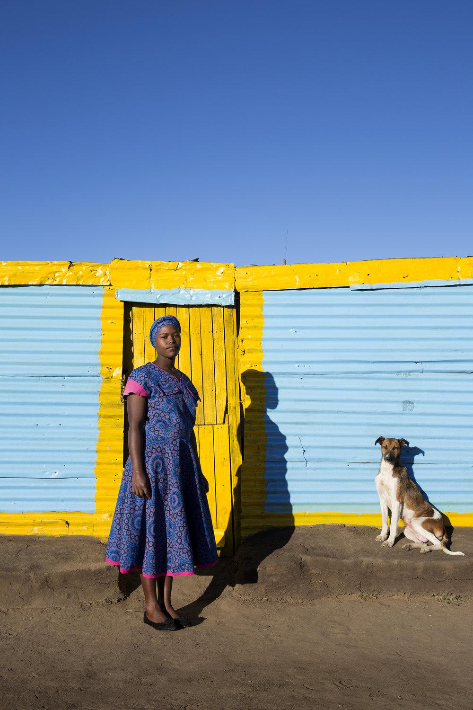 Elizabeth Monareng and her dog, Brenda, Cornelia, Free State