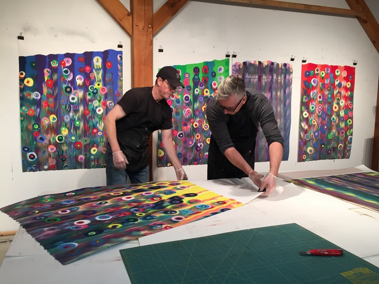 James Stroud and Markus Linnenbrink prep to hang one of the artist's new monotypes, IHEARDYOULOOKING(SCHRÄG).