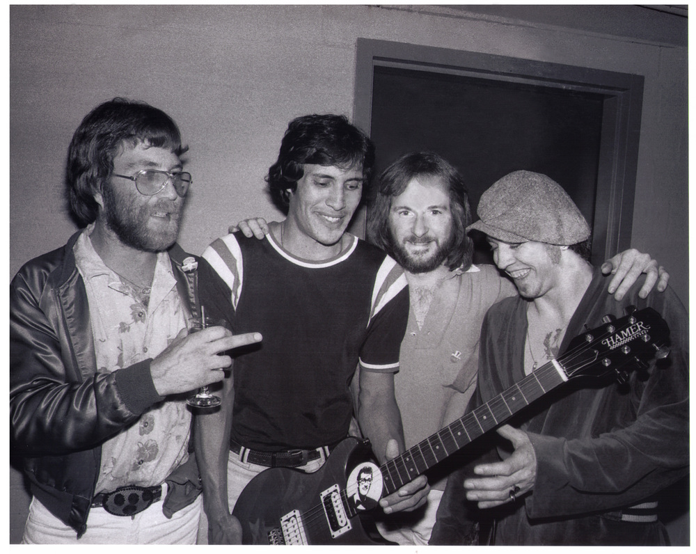 (L-R) Paul Matson, Roy Mora ,David Williams and Stevie Ray Vaughan at the Buddy Magazine Hamer guitar giveaway, 1979. ,