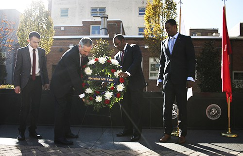 Student Association President Nick Gumas, Provost Steven Lerman, Associate Provost for Military and Veterans Affairs Mel Williams and GW Veterans President Emanuel Johnson place a wreath in front of the wall of Veterans Memorial Park. Nicole Radivilov | Assistant Photo Editor