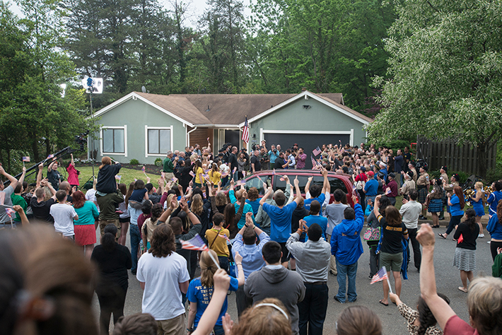 More than 300 volunteers, friends and neighors waited to greet Mark and Alicia Little outside their Fairfax home for the big reveal.  (Photo credit: Evan Cantwell/George Mason University)