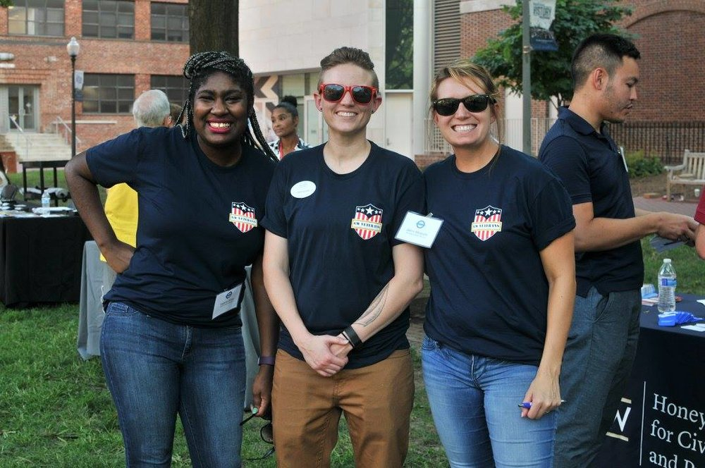 GW VALOR Student Services staff members Yelana Simms and Devin Belzer joined by Colonial Health Center's Military Services Coordinator Jen Mostafa at the 2016 GW VALOR Tailgate.