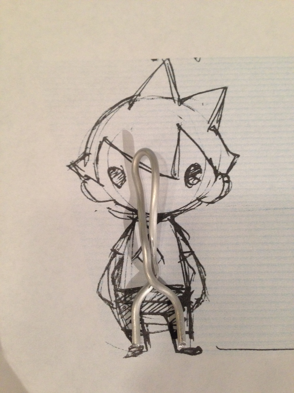 The tiny armature wire frame that I used as his skeleton.
