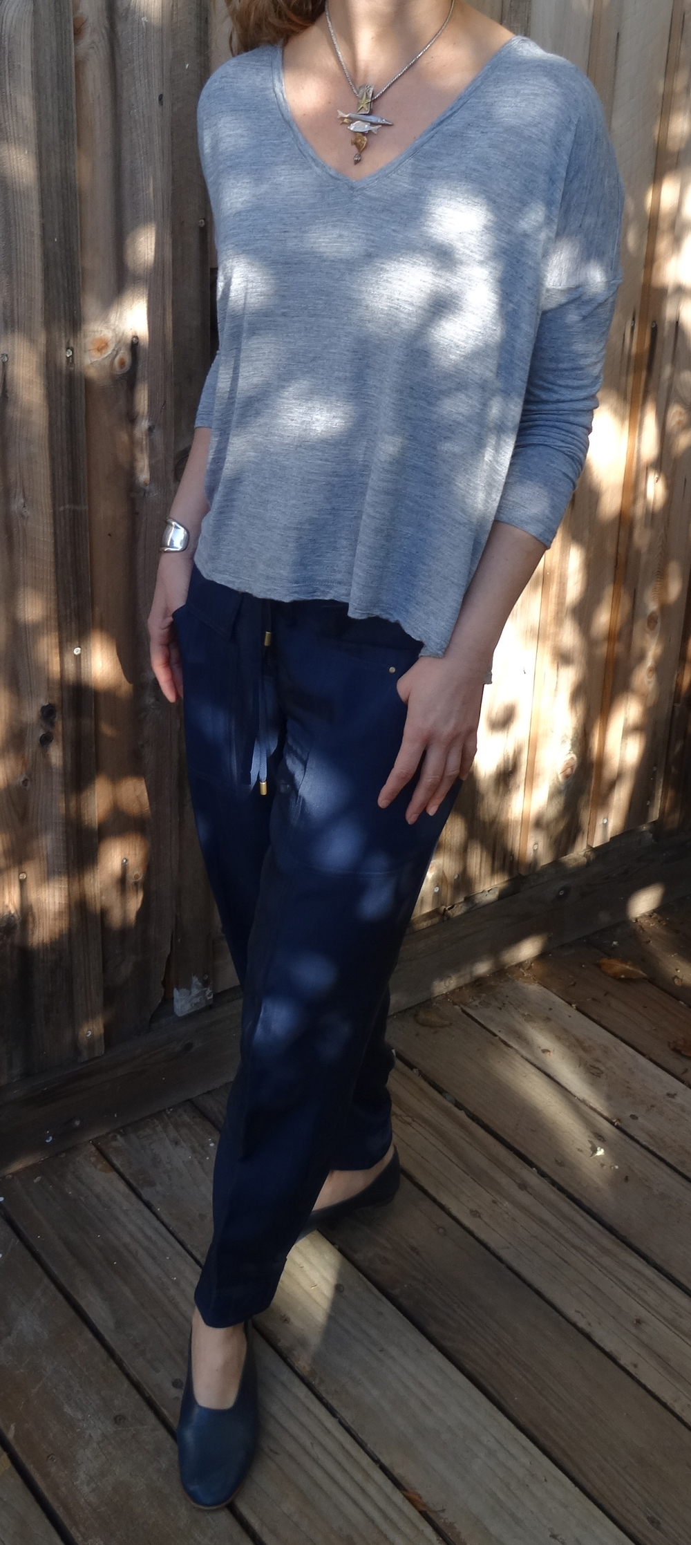 How do you balance this necklace? With a Madewell Long sleeve Tee, navy blue silk DVF parachute pants, a Tiffany's Elsa Peretti cuff and Martiniano Shoes:)