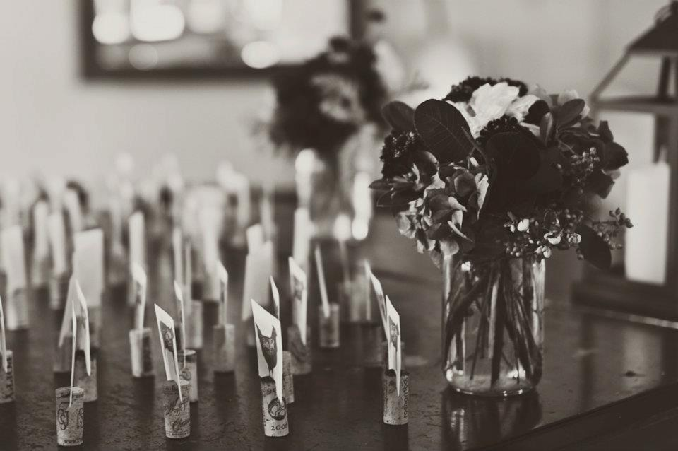 Escort Cards on grand piano with floral arrangement by Brown Paper Design.  Photo by Brown Butter Photography.