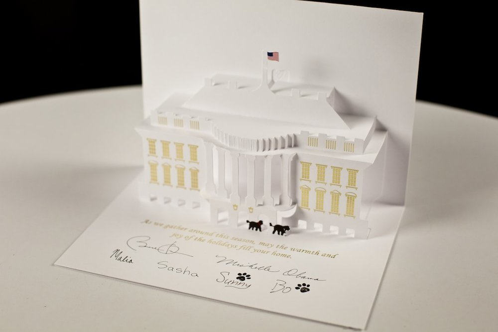 The 2013 Official White House Holiday Card was designed by Chris Hankinson and featured a pop-up White House complete with first dogs, Sunny and Bo.