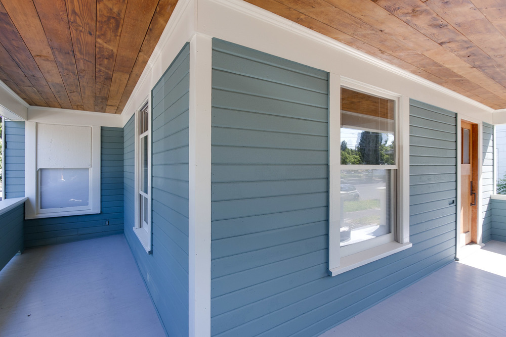 Covered porch adds charm and beauty