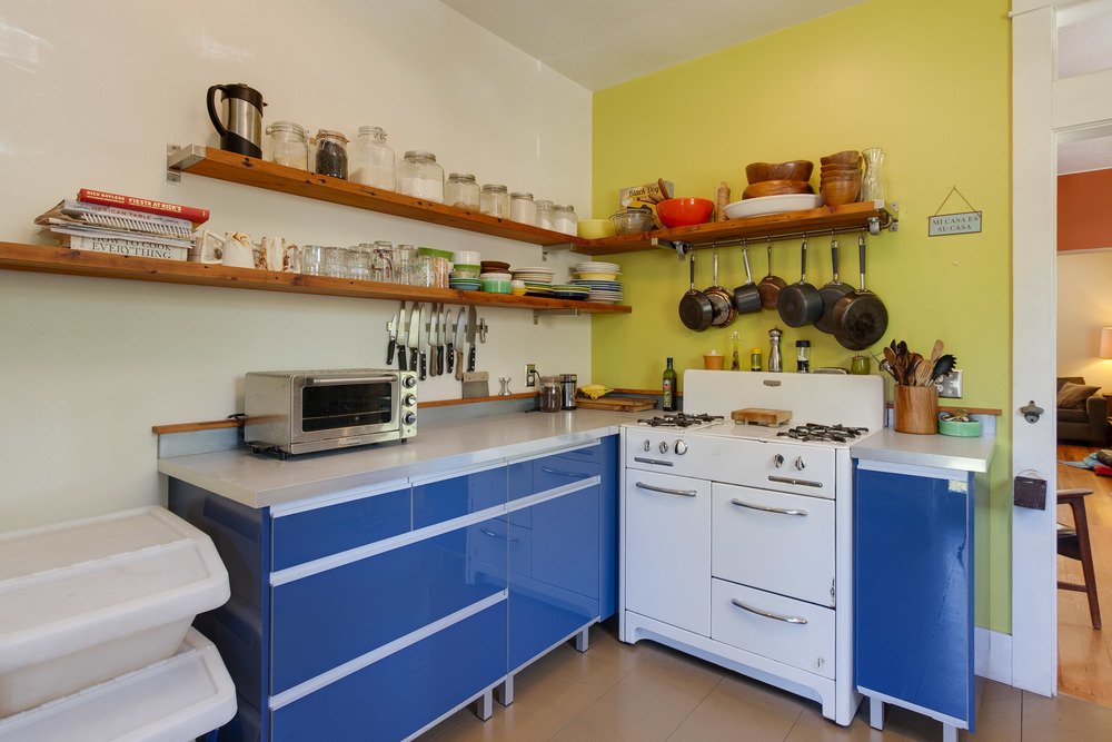 Modern cabinets with vintage stove