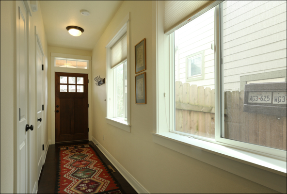 Entry hall with coat closet and door to garage