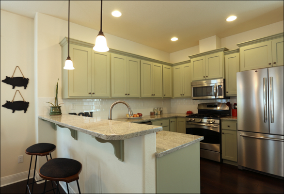 Custom painted kitchen cabinets, breakfast bar, and SS appliances