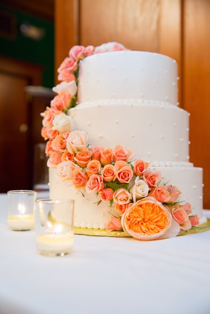 floral cascade wedding cake with peach ilse spray roses.jpg
