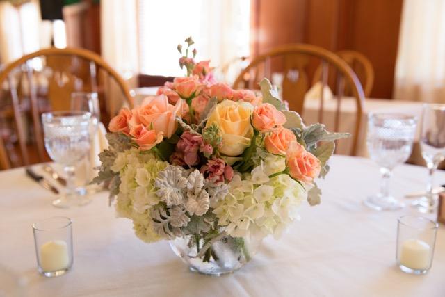 Peach Centerpieces. White hydrangea, peach stock, dusty miller, peach avalanche roses.jpg