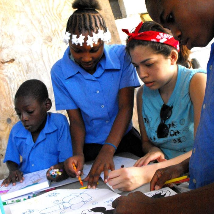 Teaching portrait drawing at Children Of Jesus Orphanage in Port-Au-Prince, Haiti during the College for Creative Studies Spring Break Service Learning Trip, 2014.