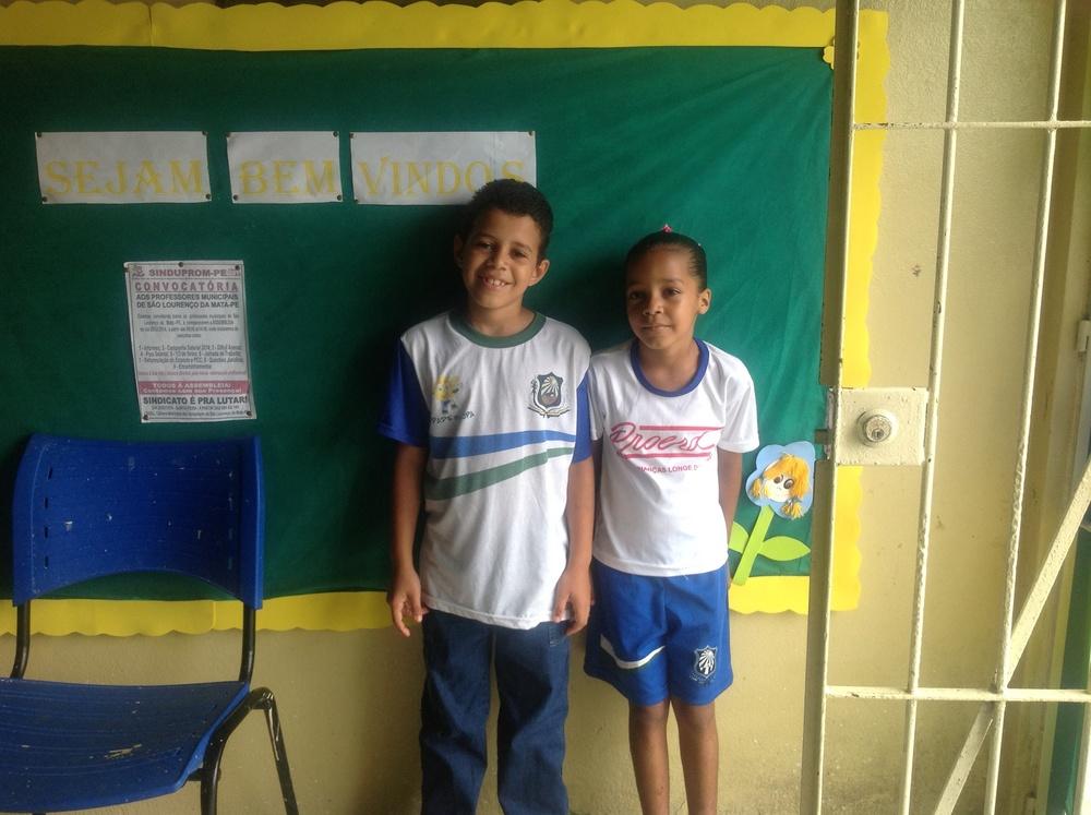 Gustavo Henrique, 10, and Bavitoria Da Silva, 6, showing off their classroom.