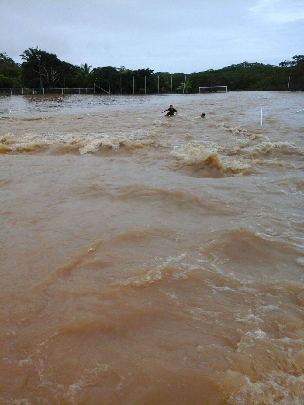 The raging flood waters wash over the Arena Massangana.