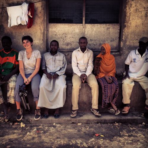 Megan and NGQ team and managers waiting to head to a game. (Zanzibar)