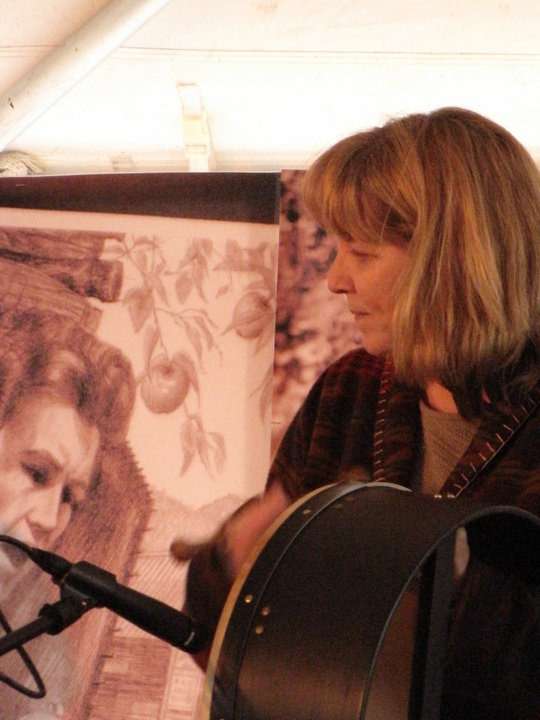 Playing on stage at the Home Crafts Day Festival at Mountain Empire Community College. That's a drawing of Janette Carter, daughter of A.P and Sara Carter, behind me; I spent a lot of time at her house when I was a little girl. The drawing is by Willard Gayheart, the artist who drew the cover of HIDING EZRA. You can read more about him at the link to his website listed under the HIDING EZRA -COVER section on the sidebar.