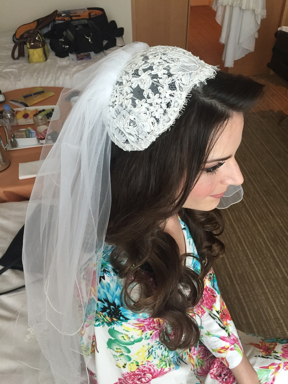 First time around this cap veil was worn covering the top of the head. By setting it back on the head 3 inches we were able to still wear it with a modern hair style.