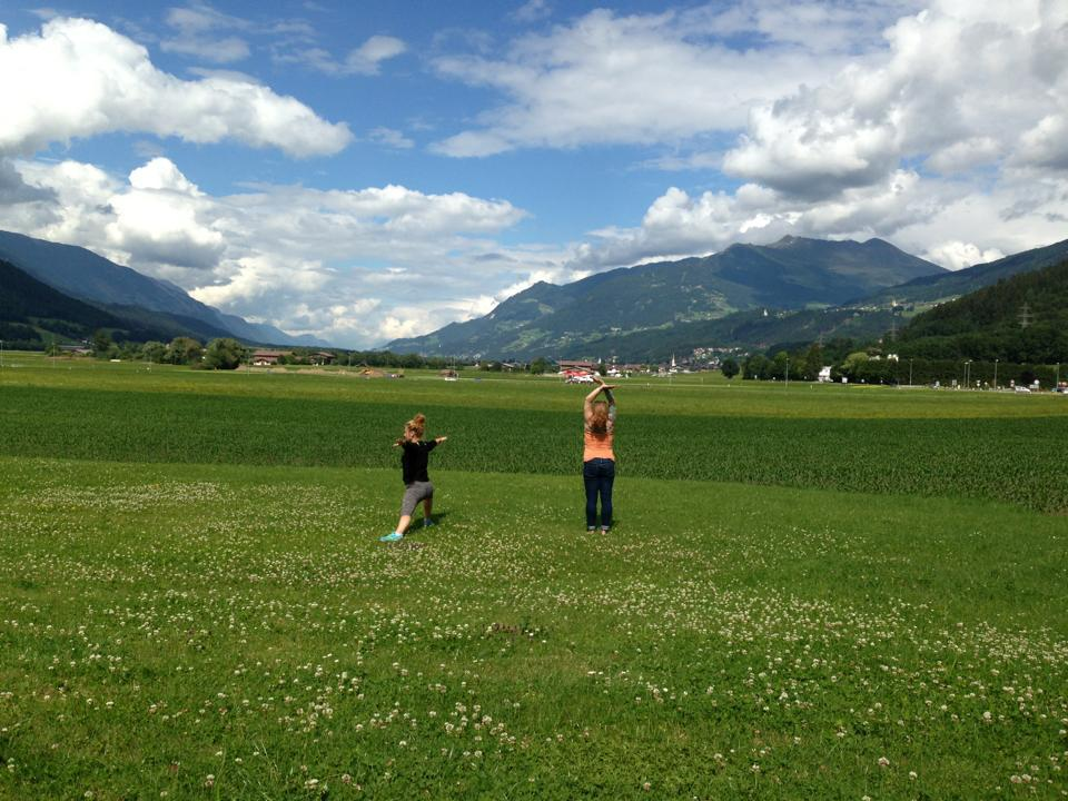 My friend Caroline and I doing sun salutations in front of the Austrian Alps this summer.