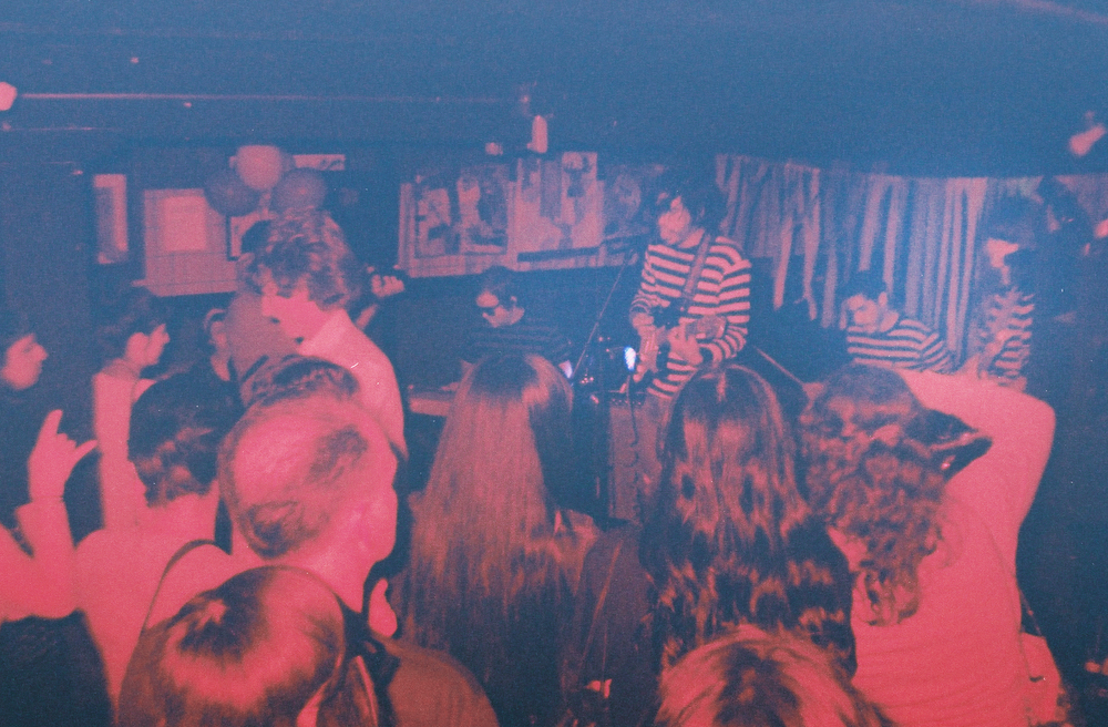 Michael Rey & The Woebegones making the basement go wild