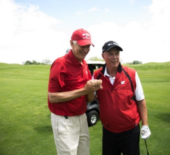 Andy and Wisconsin head basketball coach Bo Ryan embrace at Andy North and Friends Golf Outing