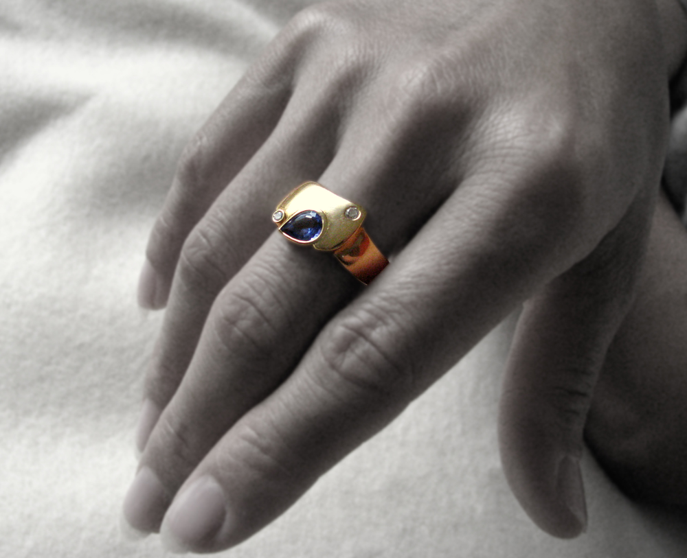 """I designed this ring for a couple that has been married for more than 30 years.  The concept was to let the gold hold the diamond ~ like a longtime marriage."""