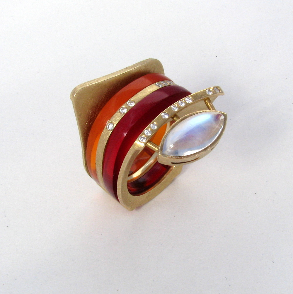 Insert -  red, orange translucent acrylic    with 18 kt gold ring and diamonds