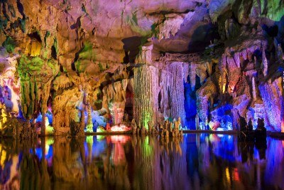 5911628-image-of-stalactite-and-stalagmite-formations-all-lighted-up-at-assembly-dragon-cave-yangshuo-guilin.jpg