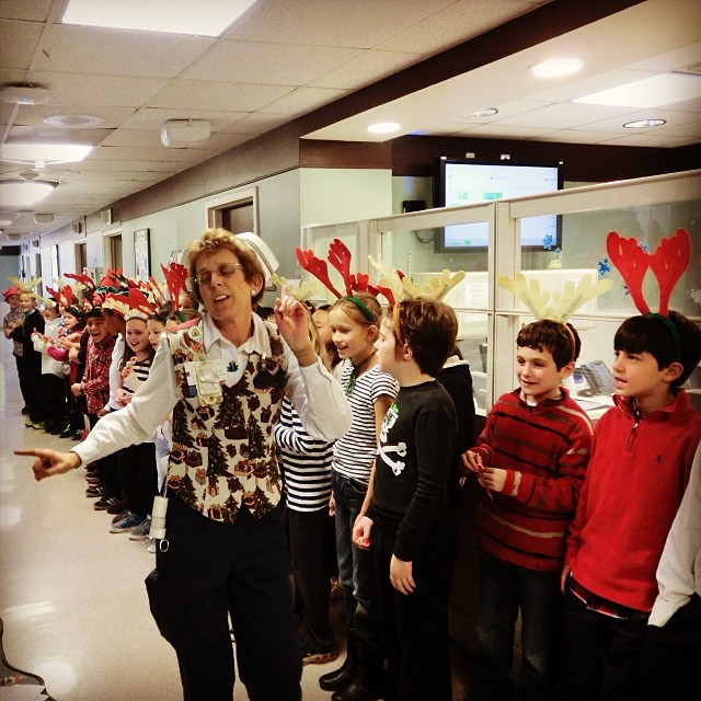 Forty 4th graders from the Ashburton Elementary School Chorus graced us with their musical talents yesterday, singing for the Oncology, Adult Surgery, PACU, Acute Medical, Cardiology and Orthopedic/Neurology units. They spread holiday cheer to both patients and staff.  Pictured here are the children singing on our Ortho/Neuro unit with Mary Anderson, RN.
