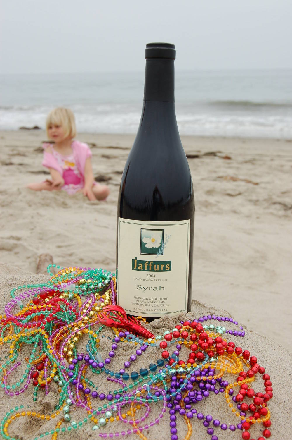 syrah bottle on beach.JPG
